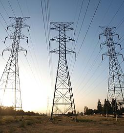 Three power towers at sunrise in smoggy Southern California.